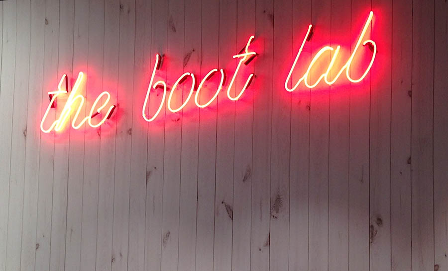 the boot lab store sign