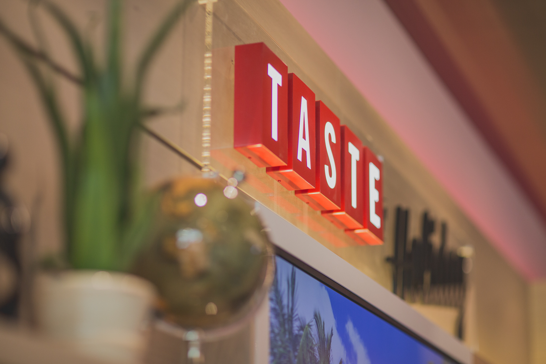Virgin Holidays Manchester Taste Sign