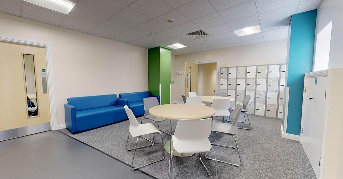 break room with lockers and chairs